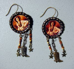 Cowgirl w Boot and Star Dangles #1122 by Kathryn Blackmun