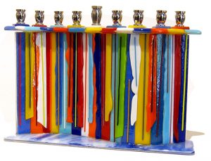 "Candle Drip Menorah by Sue Goldsand, 7"" x 10"" x 2.5"", glass, metal"