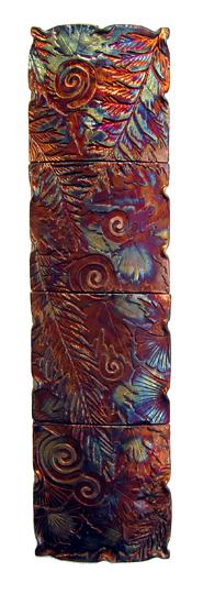 """Raku Fossil of the Future Jill Smith 24"""" x 6.5"""" x 2"""" metallic raku, wood $295"""